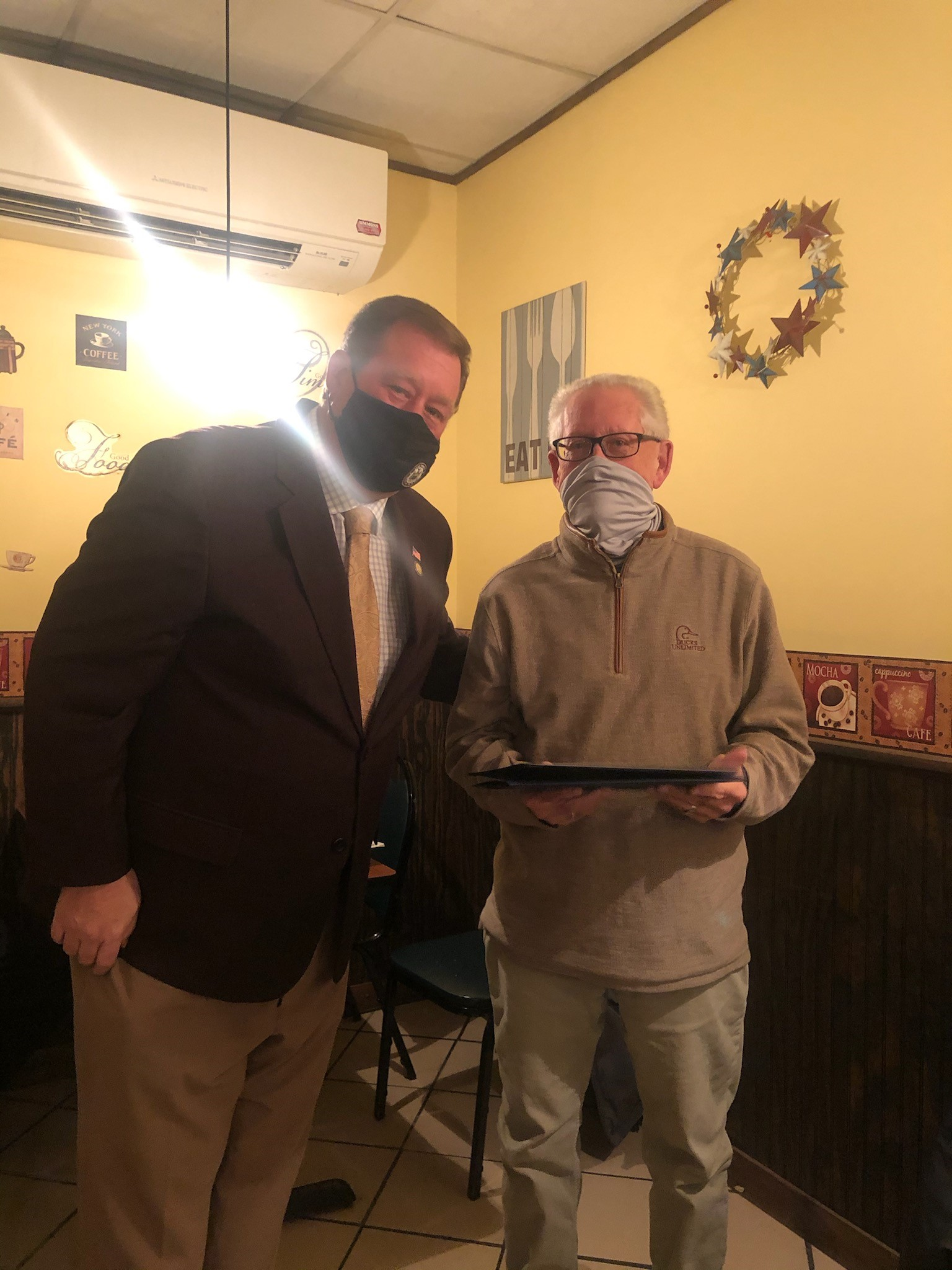 Assemblyman Chris Tague (R,C,I,Ref-Schoharie) presents Perry Kane with an Assembly Citation as well as recognitions from the New York State Senate and United States House of Representatives on behalf