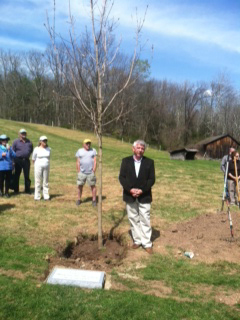Assemblymember Cahill plants a tree in honor of Congressman Maurice Hinchey at the Ashokan Center in Olivebridge, New York.