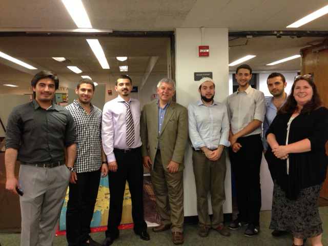 Assemblymember Cahill stands next to Turkish exchange students and their advisor at SUNY New Paltz's Turkish night.