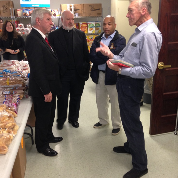 Assemblyman Cahill, Speaker Heastie, Monsignor Kevin Sullivan and Jim Kelley discuss the work being done at the food pantry