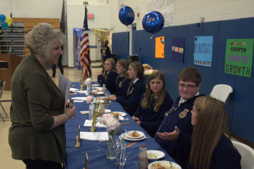 Didi speaks with students at the Future Farmers of America awards dinner at Pine Plains High School