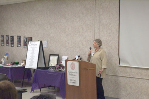 Assemblymember Didi Barrett speaks to a group of senior citizens at the Cornell Cooperative Extension of Dutchess County on World Elder Abuse Awareness day.