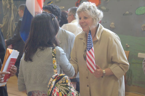 Assemblymember Didi Barrett congratulates newly naturalized American citizens at the Netherwood Elementary School.
