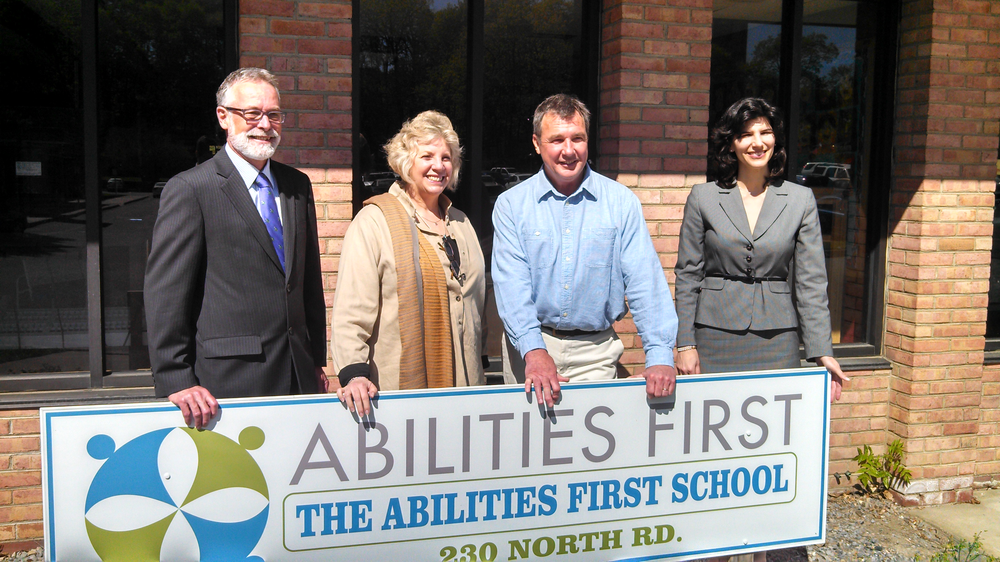 Barrett touring the Abilities First School in Poughkeepsie standing with Acting Executive Director Scott Mehlberg, School Director Bob Kelleher and Board President Jeanine Agnolet.