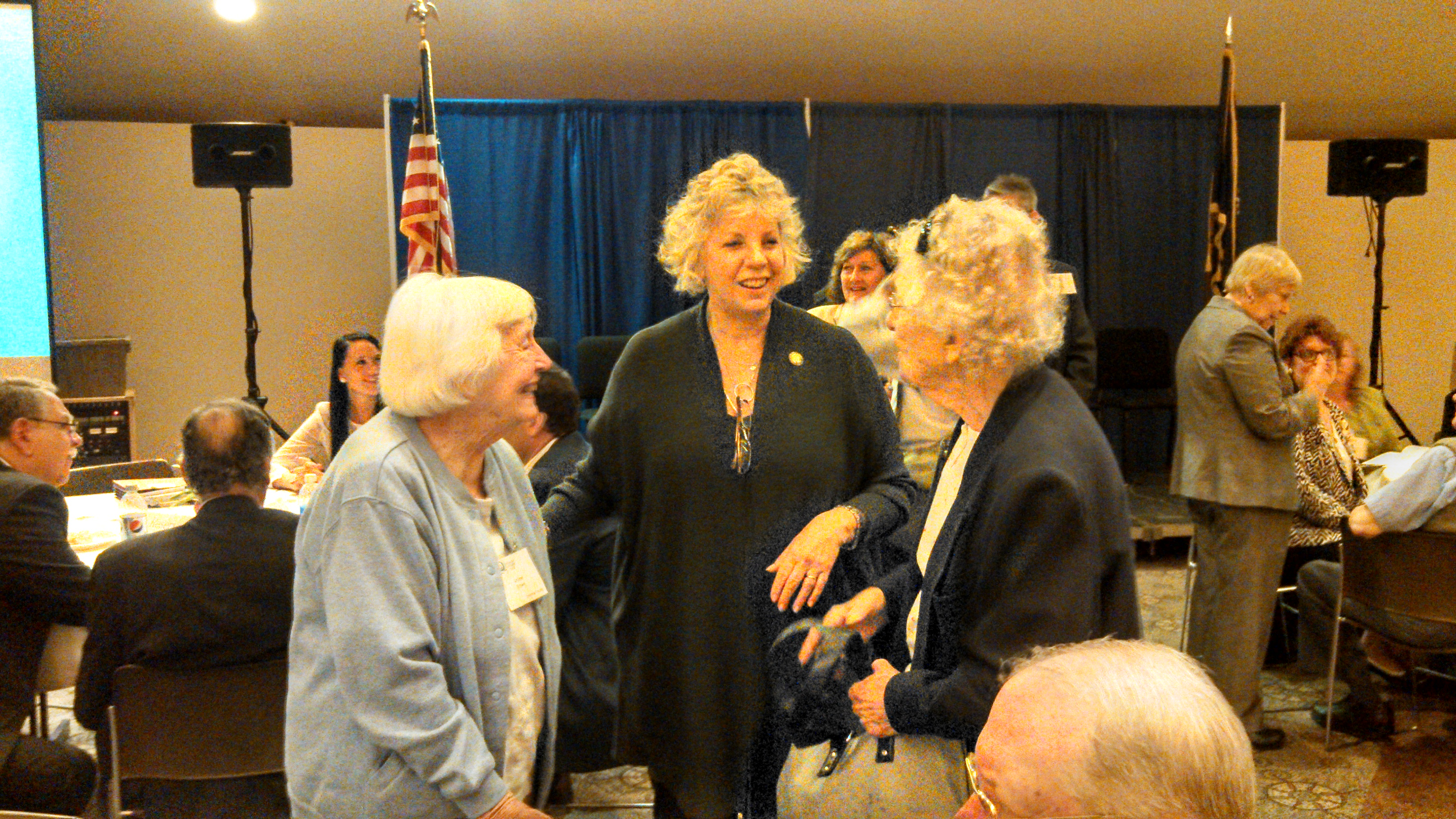 Barrett saying hello to Joyce McDonald and Arlene Brown from Columbia County during the New York State Senior Citizens Day Celebration in the Hart Lounge in Albany.
