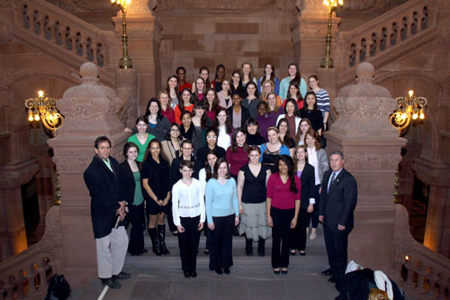 Assemblymember John McDonald welcomes members of Cornell University Women's Choir group to the Capitol at the Million Dollar Staircase prior to their tour.