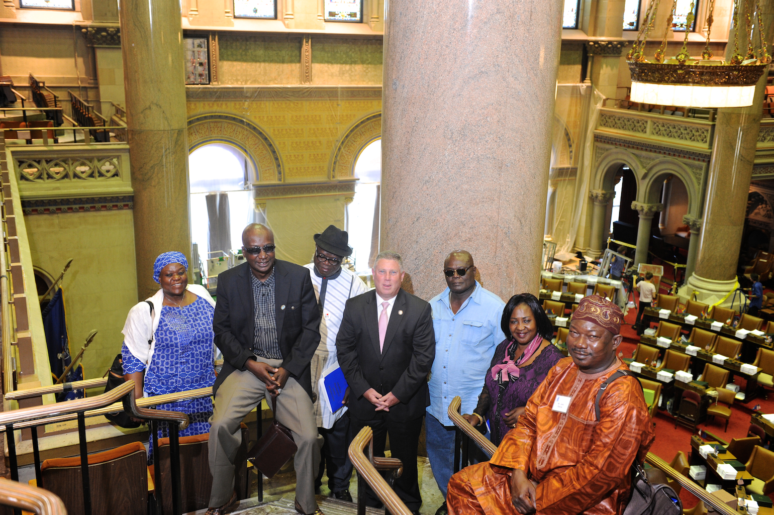 Assemblymember McDonald welcomes Nigerian delegates from the International Center of the Capital Region to the Assembly Chambers.