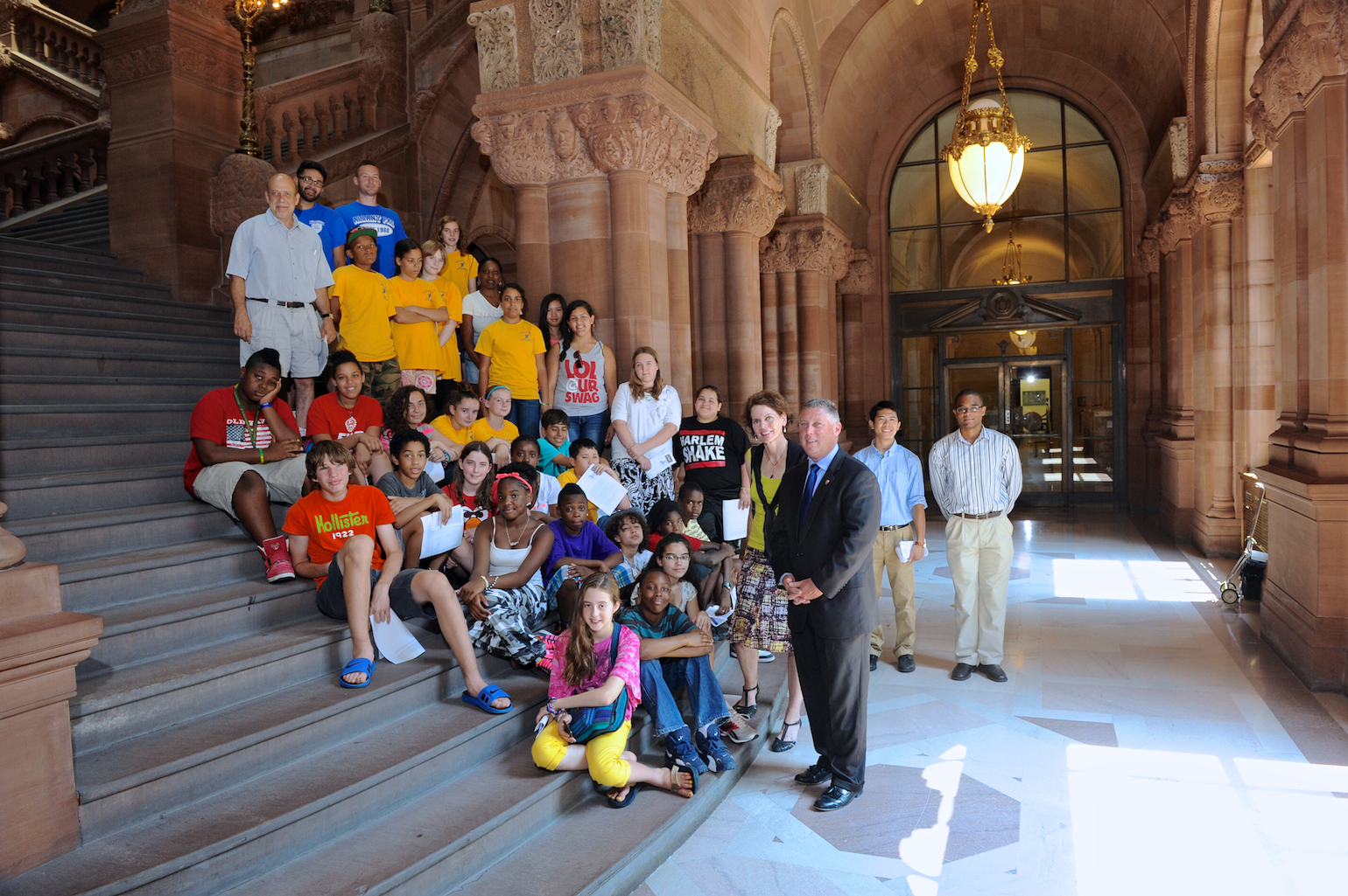 Assemblymembers Fahy and McDonald pictured with Albany Police Athletic League's Summer Camp at the Million Dollar staircase in the Capitol.