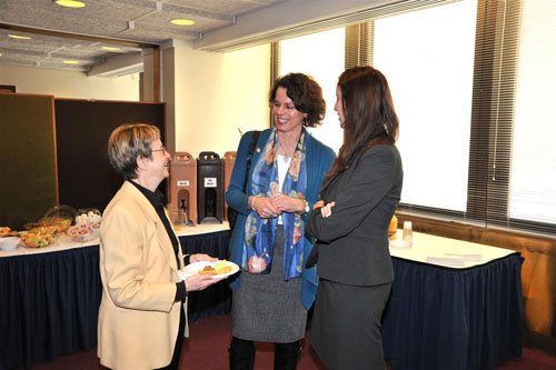 Assemblymember Patricia Fahy speaks with Assemblymember Deborah Glick, chair of the Assembly's Higher Education Committee.
