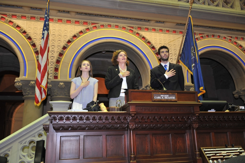 "Summer Interns Molly Ketter of Albany and Zack Malitz of Guilderland join Assemblywoman Fahy in ""gaveling"" in. The Assemblywoman, as the resident representative from Albany, continues the tradition of ""gaveling in"" every day that the Assembly is not in session, to ensure that the house is open and available for business if called upon."