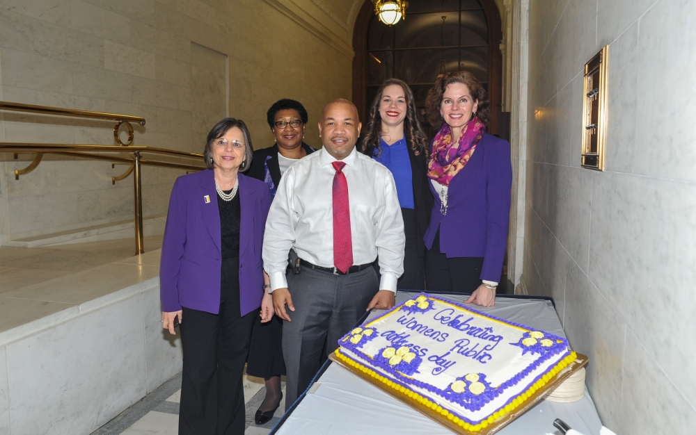 Assemblywoman Fahy joins Speaker Heastie, Assemblywoman Lupardo, Shirley Tranholm and Whitney Griffin of the Women's Legislative Caucus, to celebrate 2017 as the 100th Anniversary of Women's Suffrage in New York with tasty cake.<br />