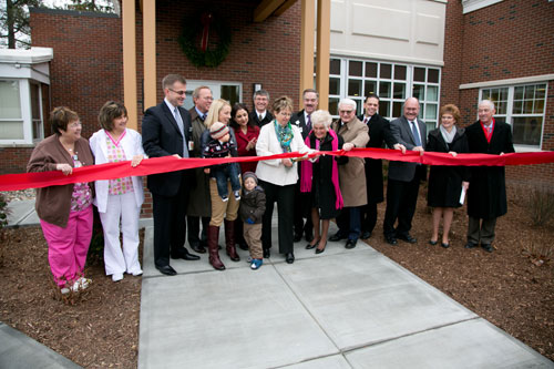 Assembly Member Phil Steck joins in the ribbon cutting of the Bellevue Women�s Center�s new Breast and Heart Health Center.
