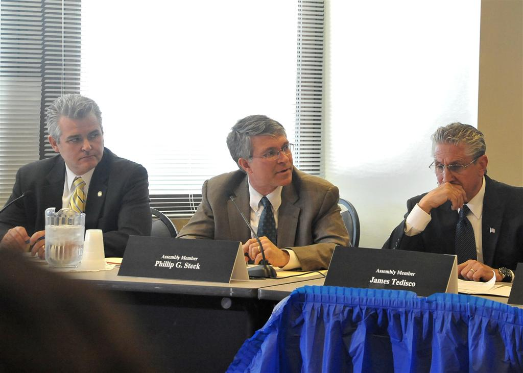 Assemblymember Phil Steck discusses education issues at a forum in the Capitol with Assemblymembers Steve McLaughlin and Jim Tedisco.