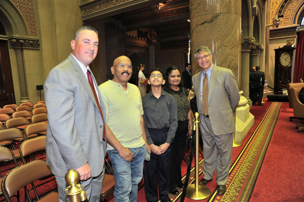 Assemblymember Phil Steck welcomes Ryan Devanandan, Scripps Capital Region Spelling Bee Champion and National Spelling Bee contestant, along with his parents, Anita and Moses Devanandan, and Sand Creek Middle School Principal David Perry to the Assembly.