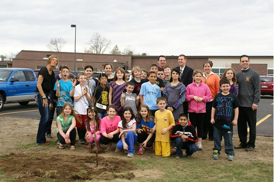 Assemblyman Angelo Santabarbara with students from Jefferson Elementary in Rotterdam. The group planted trees at the school in honor of Earth Day.