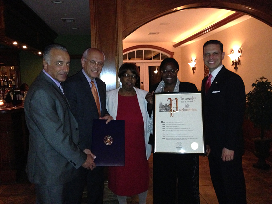 NYS Assemblyman Angelo Santabarbara presents a proclamation recognizing the Carver Community Center�s 75th Anniversary to Board Chairwoman Lola Cole and Executive Director Guido Iovinella with Congressman Paul Tonko and Schenectady City Councilwoman Marion Porterfield.