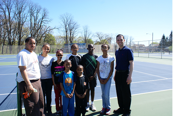 Assemblyman Angelo Santabarbara stands with members of 15-Love at the community tennis courts on Michigan Avenue in Schenectady during �Mt. Pleasant Neighborhood Clean-Up Day.�