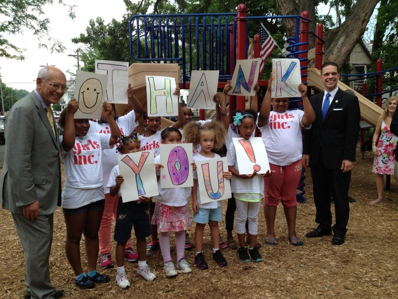 June 26, 2013 Assemblyman Santabarbara and Congressman Tonko with the Girls, Inc. campers as they offer some thanks for the dedication of their new playground on Albany Street in Schenectady.