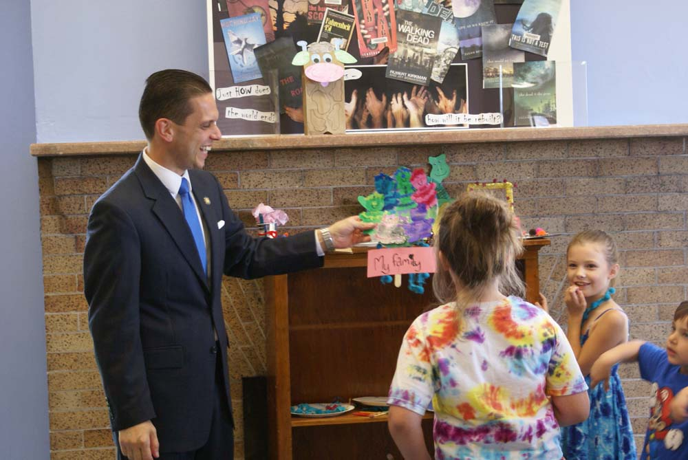 Assemblyman Santabarbara views Children�s Art Projects entries at the Amsterdam Free Library.