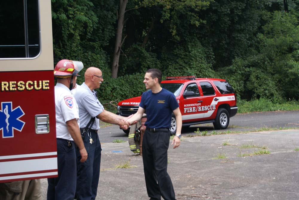 Assemblyman Santabarbara greets members of the Schenectady Fire Department.
