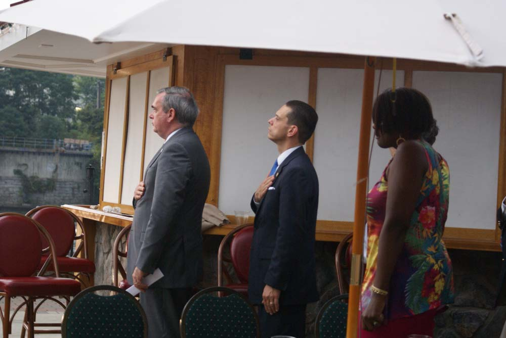 Assemblyman Angelo Santabarbara pauses during the singing of the National Anthem at Schenectady County�s 9-11 Memorial Service.
