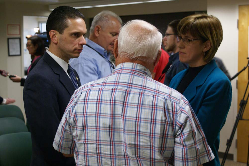 Assemblyman Santabarbara and Senator Tkaczyk speak with a Fort Plain resident after announcing legislation they are sponsoring to help ease the tax burden on homeowners affected by this summer�s flooding.