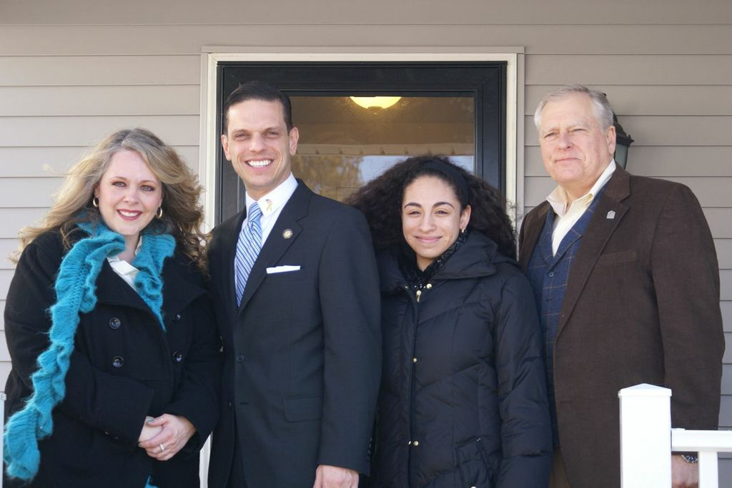 March 23rd, 2014 - Assemblyman Santabarbara stands proudly with the Jeff Clark (Exec. Dir. - a Habitat for Humanity Schenectady) and the Walker Family during the dedication ceremony for their newly completed home.