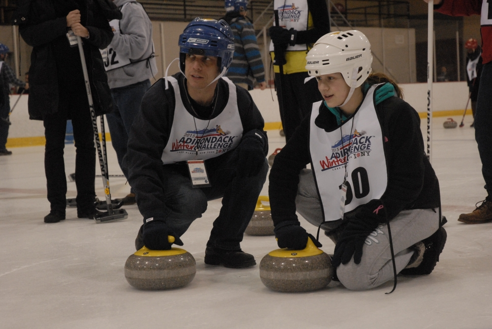 Assemblyman Angelo Santabarbara and his daughter, Marianna, try out curling as part of the Adirondack Winter Challenge in Lake Placid.  March 08, 2015