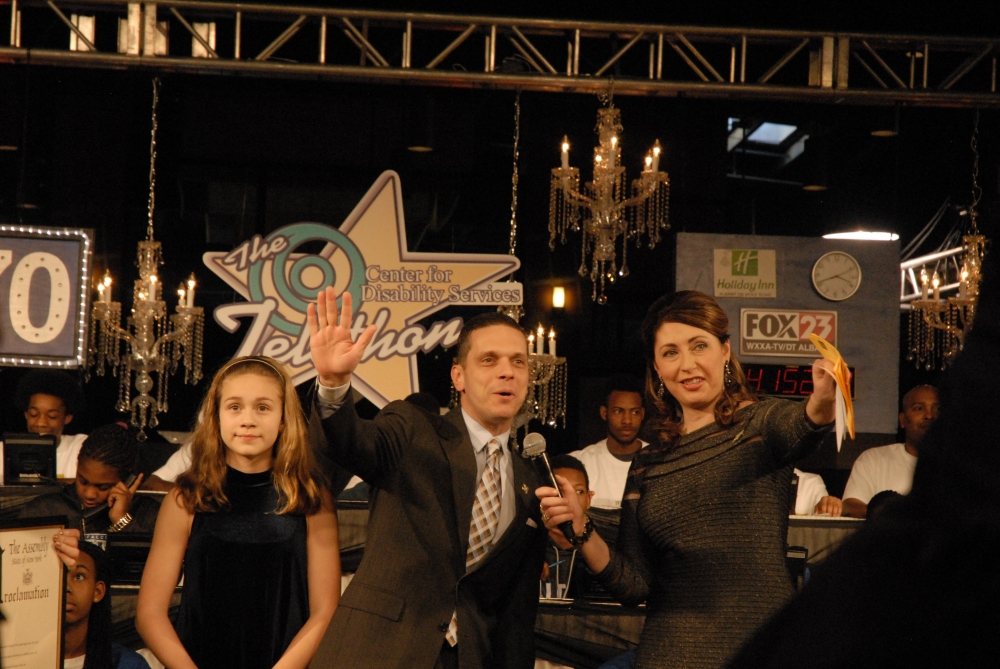 Assemblyman Angelo Santabarbara and his daughter, Marianna, join television news anchor Lydia Kulbida for the Center for Disability Services� Annual Telethon.  January 25, 2015
