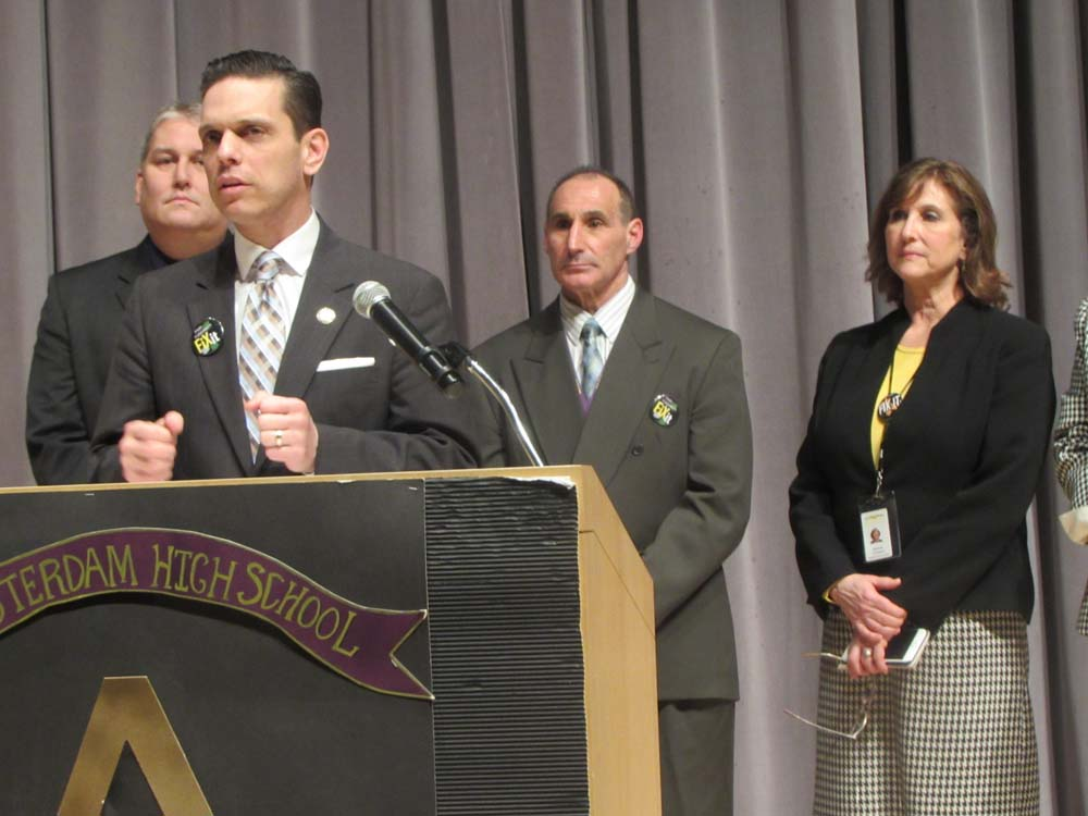 Assemblyman Angelo Santabarbara calls for fair funding and an end to the GEA as superintendents from Montgomery County school districts look on. They are, from left: Fort Plain Superintendent David Ziskin, Amsterdam Superintendent Thomas Perillo, and Canajoharie Superintendent Deborah Grimshaw.