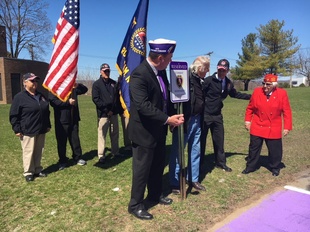 FROM LEFT: New York State Commander of the Military Order of the Purple Heart Mathew Tully, Princetown Highway Superintendent and Korean War Purple Heart veteran Nicholas Maura Sr., Assemblyman Angelo Santabarbara, and Marion Grimes of the Electric City Detachment Marine Corps League, who also serves on miSci�s Board of Trustees, are pictured following Friday�s unveiling.