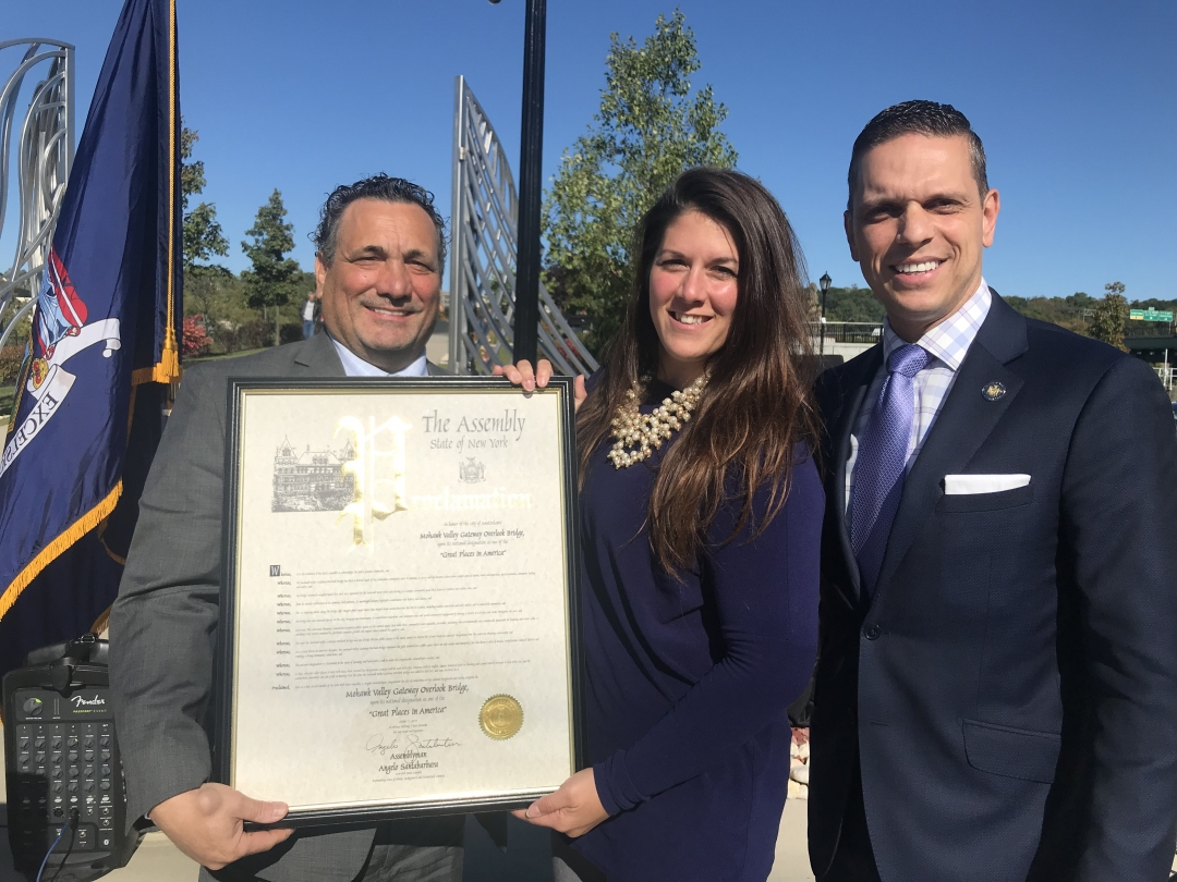 Assemblyman Angelo Santabarbara presents Mayor Michael Villa and Amsterdam City Planner Amanda Bearcroft with a New York State Assembly Proclamation in recognition of the Mohawk Valley Gateway Overloo