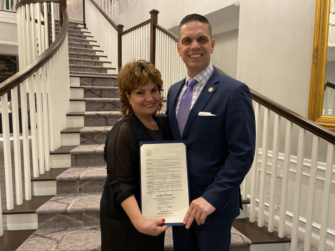 Assemblyman Angelo Santabarbara presents Ladan Alomar with a citation from the New York State Assembly at the annual Centro Civico Annual Awards Gala at the Glen Sanders Mansion on Saturday night, rec
