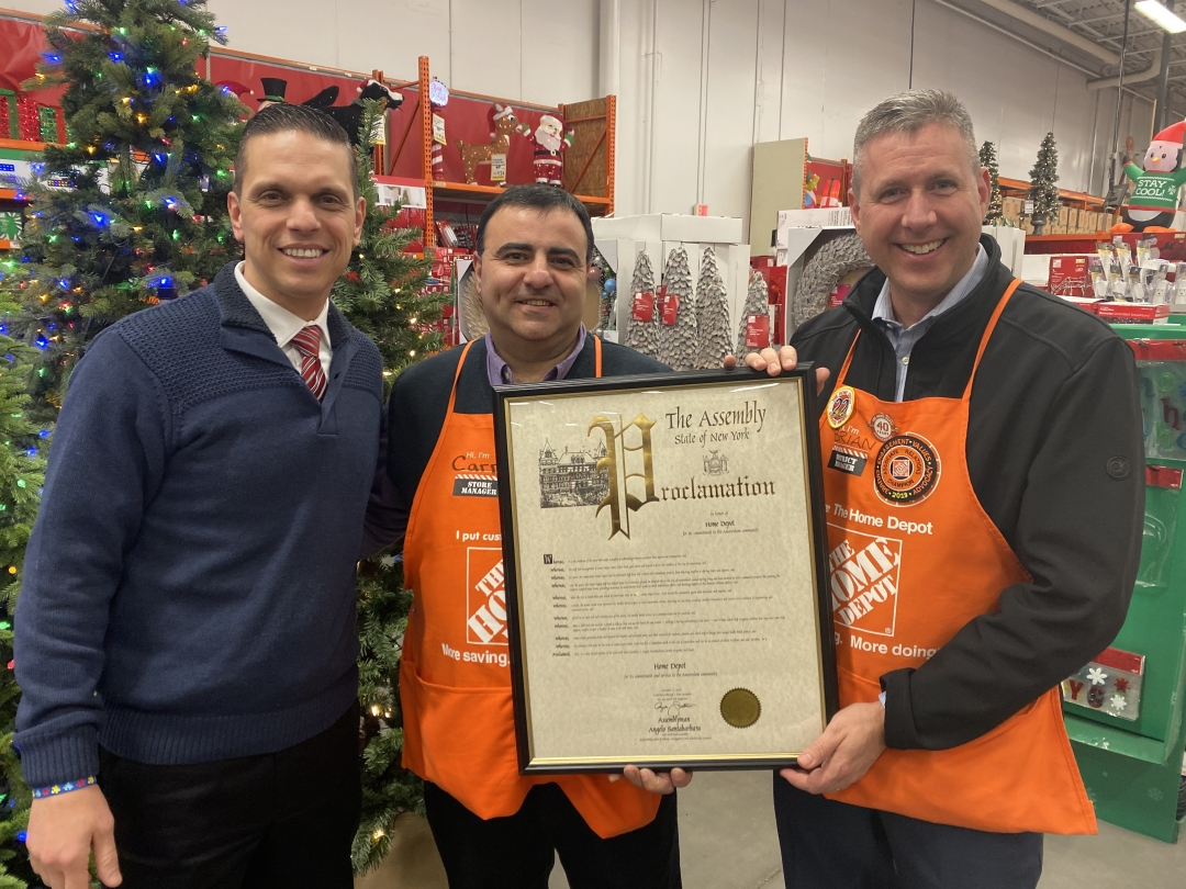 Assemblyman Santabarbara presents Home Depot (Amsterdam) store manager, Carm Carbone, Home Depot Albany District Manager Brian Kinney a New York State Assembly proclamation recognizing their support o