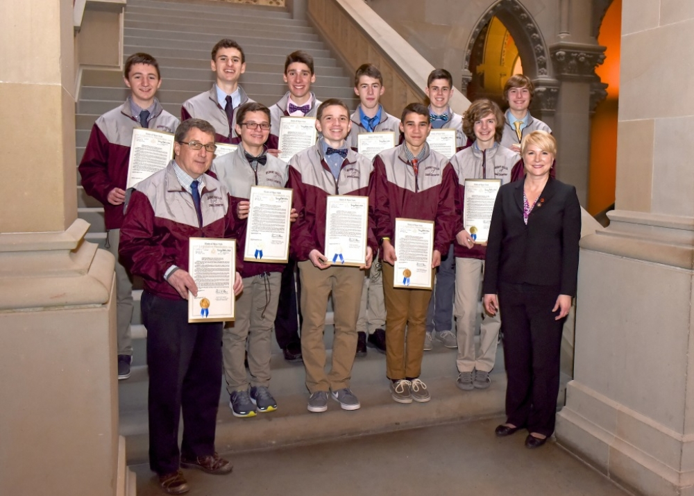 Assemblywoman Mary Beth Walsh (R,C,I,Ref-Ballston), front right, welcomed the champion Burnt Hills-Ballston Lake Boy's Cross-Country Team to the Capitol on Tuesday. The team was led by head coach