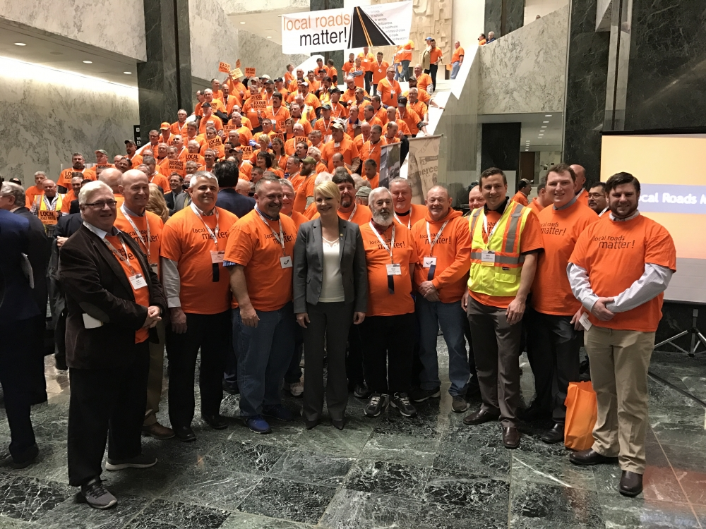 Assemblywoman Mary Beth Walsh (R,C,I,Ref-Ballston) joins local highway workers and supervisors for the annual CHIPS rally at the Legislative Office Building on Wednesday.