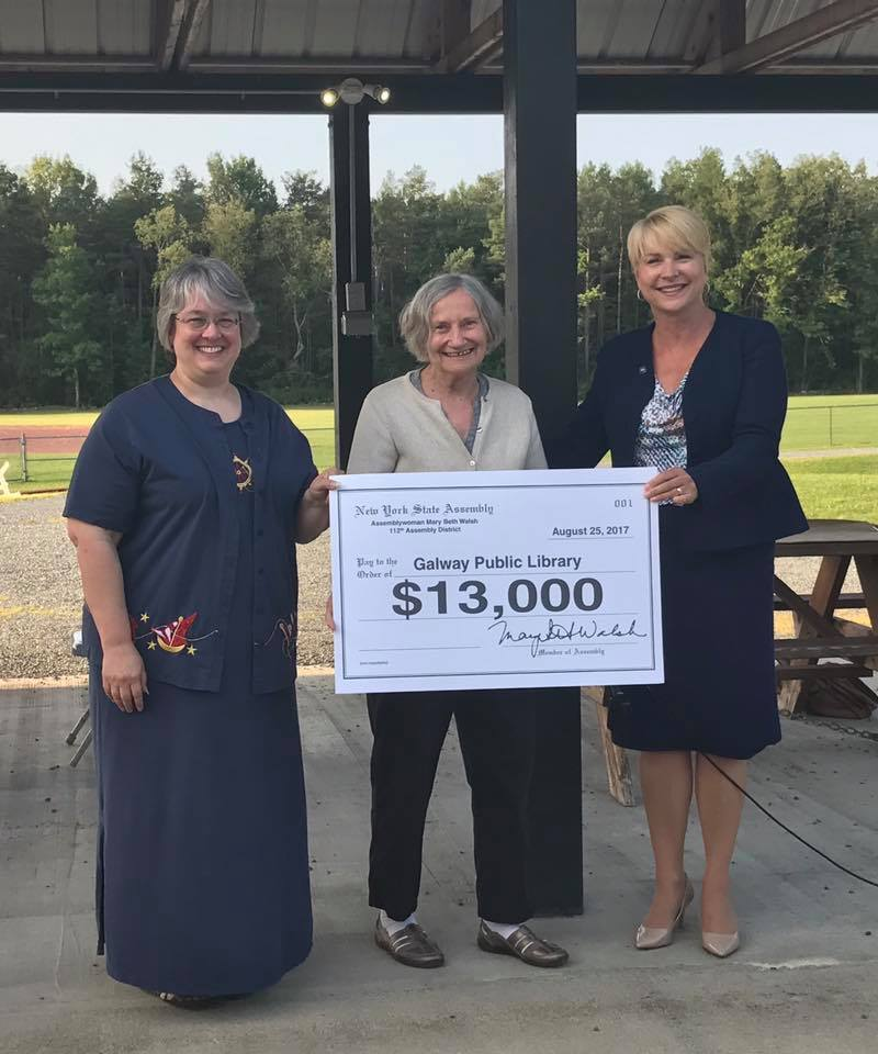 Assemblywoman Mary Beth Walsh (R,C,I,Ref-Ballston) presented a $13,000 contribution to support the Galway Public Library at a Community Ice Cream Social on Friday, August 25.