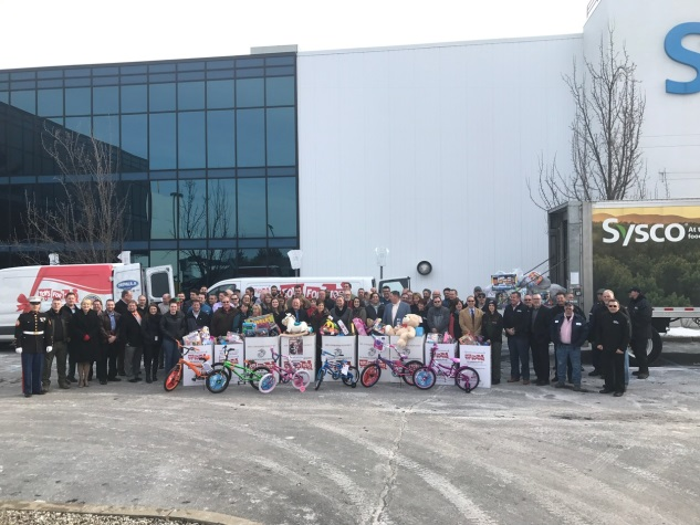 (Left to right) Assemblywoman Mary Beth Walsh, SYSCO Albany employees and President Mike Pilkington and Toys for Tots representatives celebrated the organizations' successful holiday toy drive in