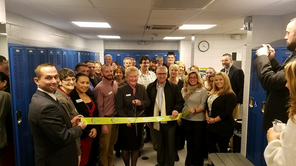A ribbon-cutting in the men's locker room at the Glenville YMCA? Just one of the many perks of the job! Congratulations Donna Gigone, the new locker rooms look great!