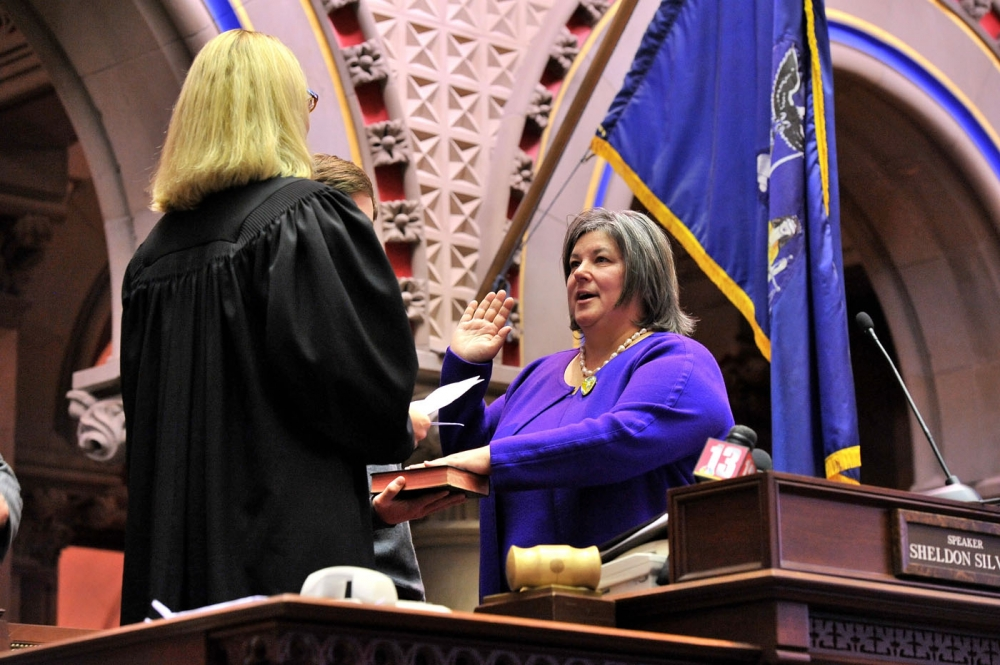 Assemblywoman Carrie Woerner is sworn into office by Judge Christine Clark