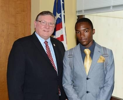 Assemblyman Ken Blankenbush (R,C,I-Black River) welcomes Ft. Drum Youth Services' Youth of the Year Antonio Bell, Jr.