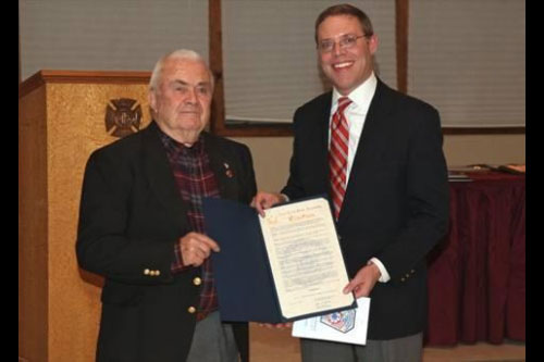 Assemblyman Will Barclay (R,C,I�Pulaski) recently presented Irving Candee, left, with a New York State Assembly Citation.  Candee has served the Belgium Cold Springs Fire Department for 60 years.  This occasion was recently celebrated at the fire department�s annual installation banquet, held at Lakeside Fire Department Recreational Hall.  Candee has been a firefighter since Dec. 6, 1951.  During that time, he served as assistant fire chief, chief, secretary, and on the board of directors.