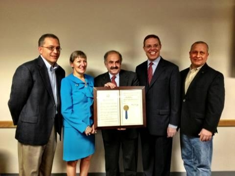 Several colleagues attended the honoring of Dr. Uva. From the left are Oswego Health Medical Staff President Dr. Ivan Proano, President and CEO of Oswego Health Ann Gilpin, Dr. Ronald Uva, Assemblyman Will Barclay and Chair of Oswego Health Board of Directors Thomas Schneider.