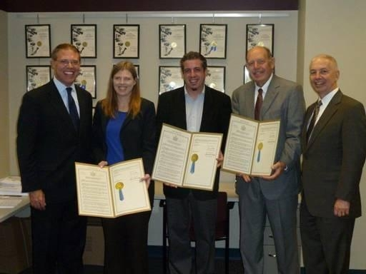 Assemblymen Barclay and Oaks presented WRVO with State Assembly resolutions for receiving the Edward R. Murrow award for their documentary �New York in the World.� From the left are Assemblyman Barclay, WRVO News Director Catherine Loper, Senior Producer Mark Lavonier, General Manager Michael Amiegh, and Assemblyman Bob Oaks.