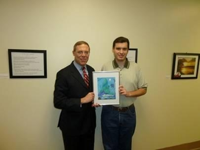 Jeremy Kelley (right), holding his work titled �Bald Mountain� with Assemblyman Barclay.