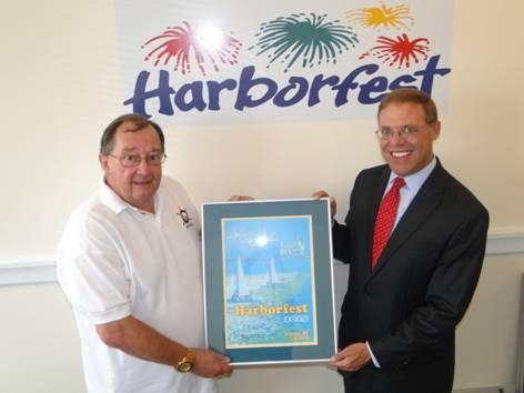 Doug Buske, Executive Director of Harborfest, left, presented Assemblyman Will Barclay (R,C,I�Pulaski) with a framed print of the official Harborfest poster and brochure cover.  The winning design was created by G. Ray Bodley student Chlarissia Crast. Harborfest will take place July 23-26 in Oswego.