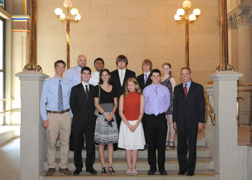 The West Genesee High School Academic Decathlon Team recently traveled to Albany.  They were recognized on the Assembly floor with a Resolution. From left, in front, are Thomas Brogan, Matt Serrao, Kaitlyn Richards, Jenny Smacher, Kevan Spencer and Assemblyman Will Barclay. In back, from left, are Coach Scott Duda, Jerry Roy, Alec Kearns, DJ Campbell and Caitlin Nolan.