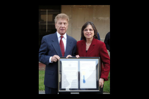 October 11, 2011 � Assemblywoman Donna Lupardo presents Dr. Sandro Sticca from the Abruzzese Social Club with a resolution commemorating the 150th anniversary of the unification of Italy at the Columbus Day flag raising ceremony in Binghamton.