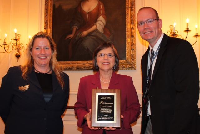 September 19, 2013 � New York Aviation Management Association President Ann Crook and Board of Directors Member Carl Beardsley present Assemblywoman Donna Lupardo with the 2013 NYAMA President�s Award.