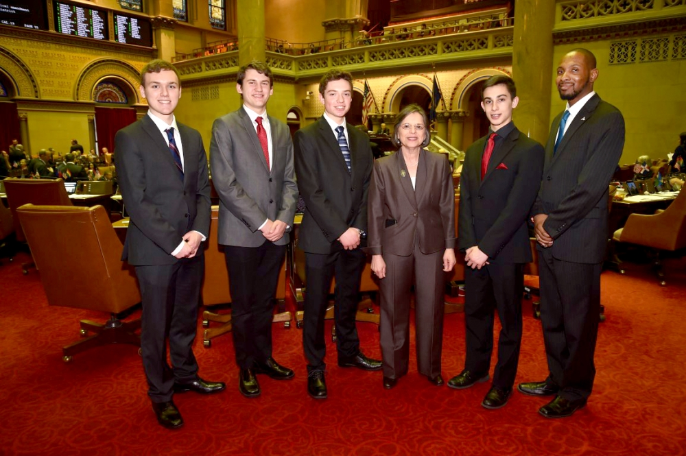February 24, 2016 – Members from Union-Endicott High School's Mock Senate meet with Assemblywoman Lupardo on the chamber floor.